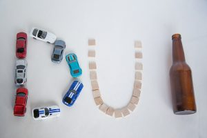 DUI spelled with objects that cause intoxication