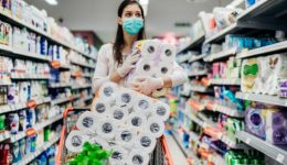 Toilette paper shortage.Woman with hygienic mask shopping for to