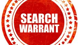 search warrant, grunge red rubber stamp with rough lines and edg